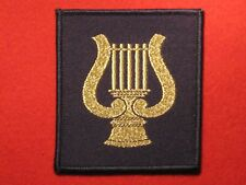 BRITISH ARMY CAMUS CORPS OF ARMY MUSIC TRF BADGE