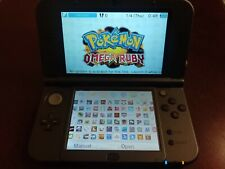 New Nintendo 3DS XL Black 128gb sd with 170 games installed + charger + stylus.