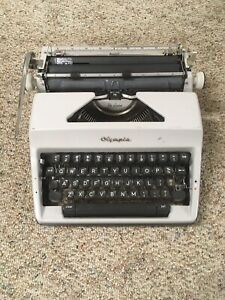 Vintage Olympia Deluxe Typewriter With Carrying Case
