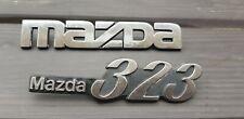 GENUINE MAZDA 323 BADGE EMBLEMS BADGES RARE