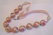 Great statement style fabric floral pink ribbon necklace approx 74 cm long