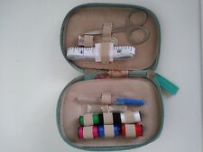 Compact sewing kit purse