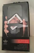 "2.4"" Portable photo album by The Sharper Image up to 200 images great gift"