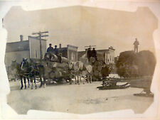 1880s logging, two-horse teams hauling timber on sleighs; original photo, snow
