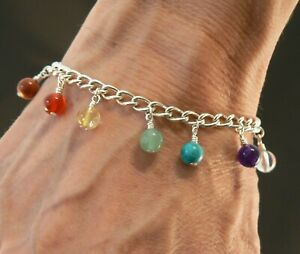 Chakra gemstone charm bracelet with hand-wrapped beads on a silver-plated chain
