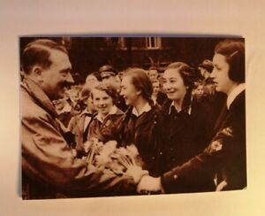 Hitler receives flowers from young German girls.  Military Propaganda postcard.