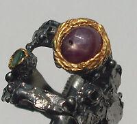 CeS Ring mit einem Sternrubin, Rubin und Smaragd