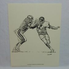 1981 SHELL OIL PRINT ALAN PAGE CONFRONTS AN OFFENSIVE CHARGE