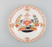 Meissen plate in hand-painted porcelain with floral decoration and gold edge.