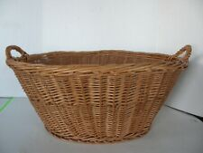 LARGE OVAL WICKER BASKET WITH HANDLES