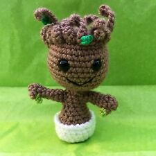 Crocheted Mini Groot In A White Pot Amigurumi Stuffed Toy.