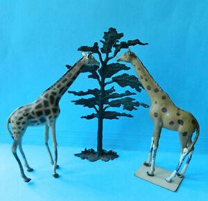 2 Vintage Wm. Britains 54mm painted metal giraffes & one tree toy figures