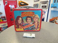 vintage dukes of hazard lunch box and boss hos Cadillac