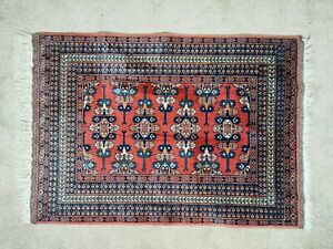 A Shiraz rug decorated with stylised motifs and flowers 126 cm x 88 cm