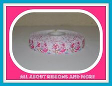 7/8 INCH HELLO KITTY WITH FLOWERS ON WHITE GROSGRAIN RIBBON-1  YD