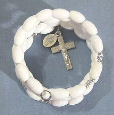 Rosary bracelet, white plastic beads w silvery crucifix etc on memory wire wkb