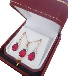 Yellow gold finish pearcut Ruby & cluster created diamond necklace and earrings