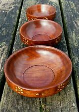 Set of three wooden fairtrade snack party bowls.