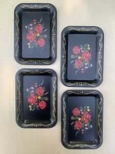 Set of four small vintage trays, black with floral design
