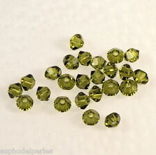 50 perles  toupies en cristal de Swarovski  5328 Olivine 3 mm