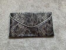 Meli Melo Large Leather Clutch Bag.