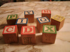 Lot of 9 wooden alphabet blocks  Some have letters/some are Sesame Street