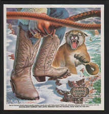 1983 NOCONA Boots - COWBOY with WHIP & MOUNTAIN LION - ALEX EBEL ART VINTAGE AD