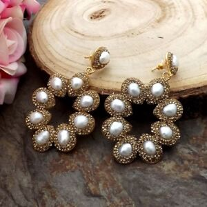 white Pearl trimmed with golden macarsite stud Earrings