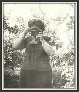 Woman Girl Photographer hidding Camera covers face USSR vintage photo duel shoot