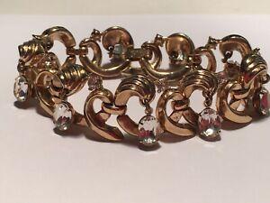 "Fabulous Crown Trifari 7"" bracelet gold tone with dangling oval rhinestones"