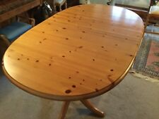 Extending oval pine dining table