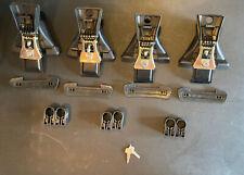 Set (4) Yakima Q Towers and (4) Yakima SKS Lock Cores; USED