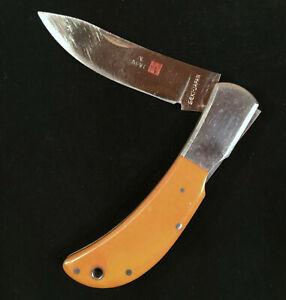 Vintage 1980s AL MAR SEKI JAPAN folding lock-back knife, yellow micarta 7-1/8 in