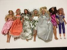 Barbie lot of (7) dolls. Good shape. New And Vintage With Clothes