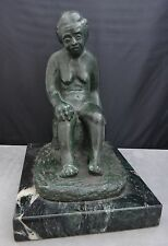 patinaed bronze sculpture of a woman