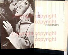 468226,Filmszene Marilyn Monroe Liebe Paar Kuss