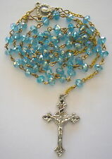 Rosary LIGHT-BLUE Crystal beads 6mm with 40mm shapely cross and Marian Centre.