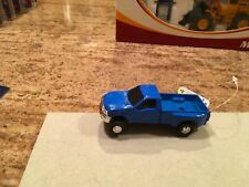 1/64 Ertl Blue Ford F 350 dual rear wheel pick up truck