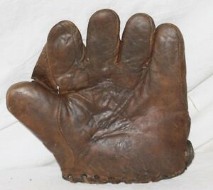 "1910's-20s Champion McKinnon 1"" Web Baseball Glove. Measures 8.5"" Wide x 9"" High"