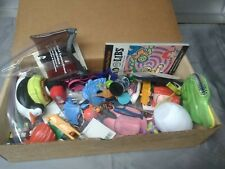 geocaching swag box full small trinket items hiding outdoor maps