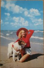 1950s Chrome Pinup Postcard: Girl with Collie Dog on the Beach, Hat