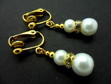 A PAIR OF SHORT DANGLY WHITE  GLASS PEARL  GOLD PLATED CLIP ON   EARRINGS.