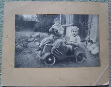 photograph children in 1940's 1930's toy peddle car