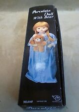 Porcelain doll with bear made by price products number 5147 copyright date 1983