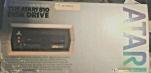 Atari 810 Disk drive with dust cover, manual & box- WORKS - and trakball w/games