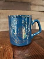 COLT FIREARMS FACTORY BLUE & GOLD CERAMIC COFFEE MUG 1986 GOLD IS FADING