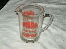 A Vintage 1960's Clear Glass Red Enamel Pyro Ceramic Corio Whisky Water Jug