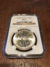 1985 NCG MS67 MO .999 Silver Libertad Coin Onza