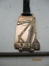 Vintage Manitowoc Crane Watch Fob with Black Plastic Band