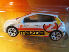 MATCHBOX MAZDA 2 WHITE CAR SCALE 1/64 - WHITE RIM'S - NEW ON LONG CARD